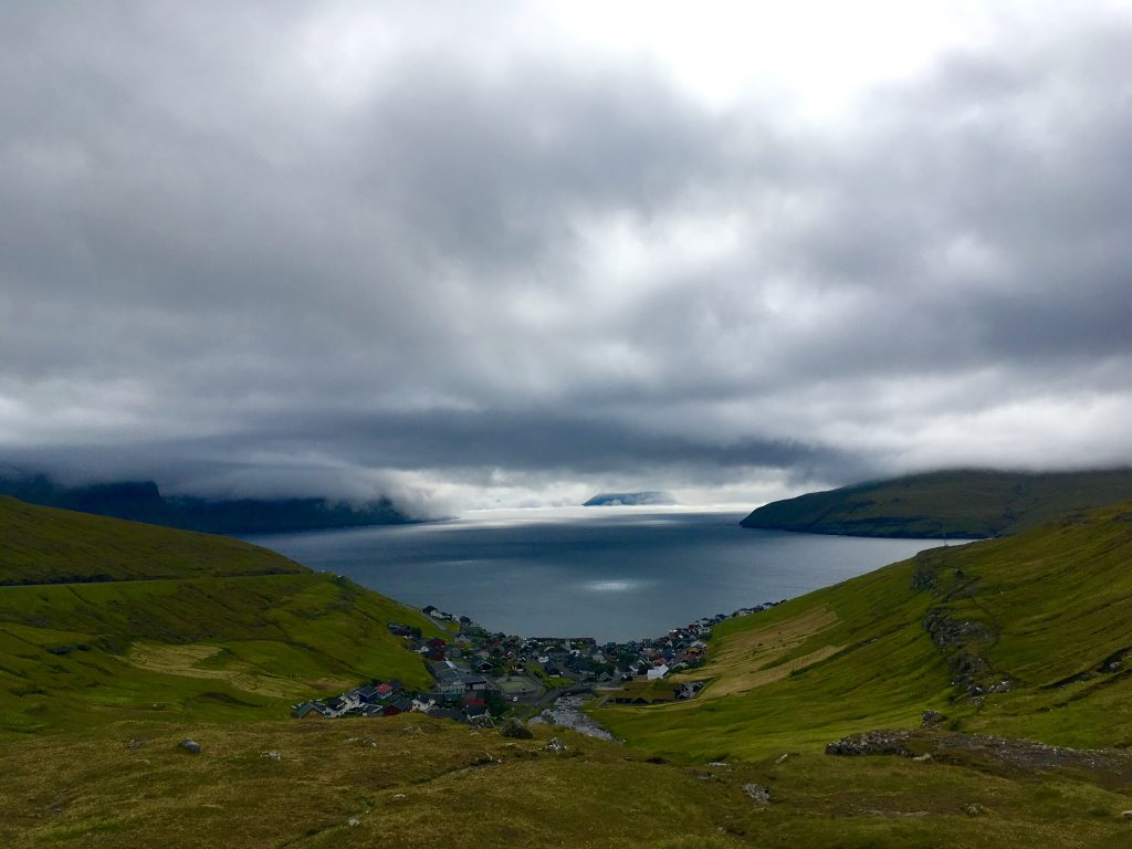 A village nestles within the valley on the drive from the airport to the capital of Tórshavn. (c) Kate Chapman