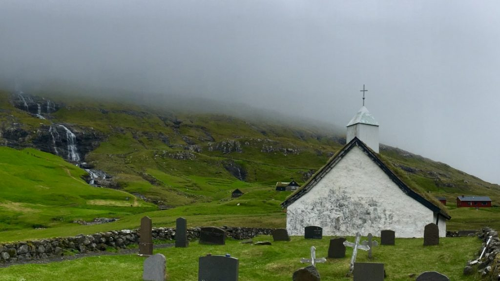 Remote and peaceful, Saksun's church remains unchanged since it was built in the 1800s and with a giant waterfall close-by, it is a breathtaking sight. (c) Kate Chapman