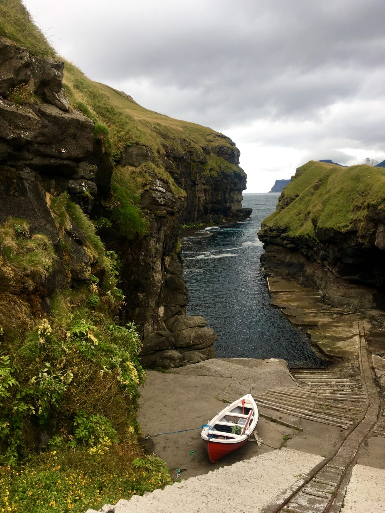 The village of Gjógv, situated on the tip of the island of Eysturoy, is set around a sea-filled gorge, hewn from the ragged rock by seas that whip and roar. (c) Kate Chapman