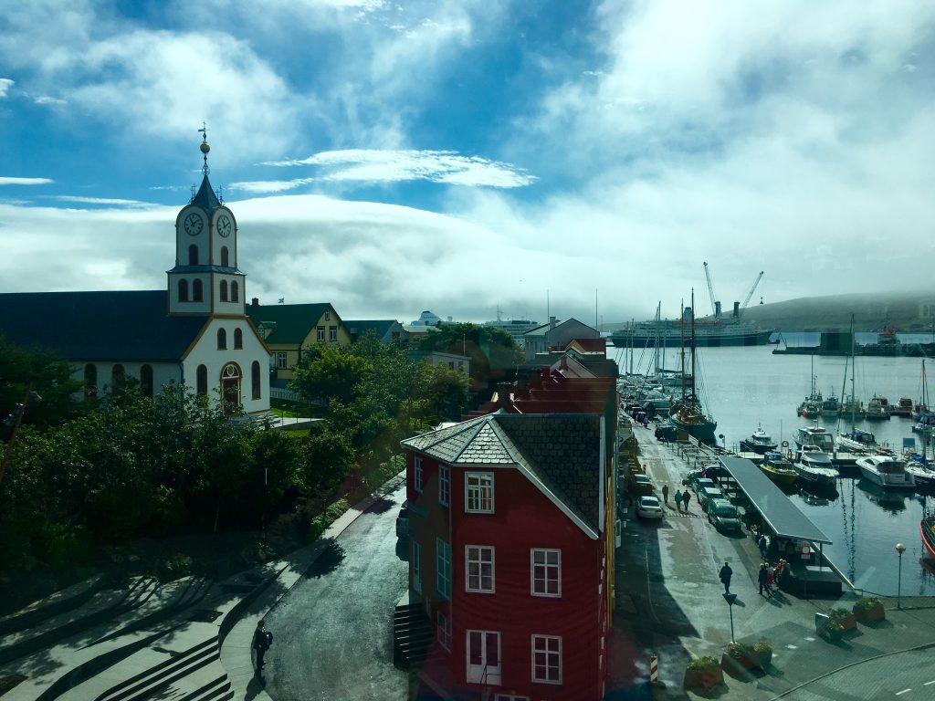 The Faroes' colourful capital of Tórshavn is one of the smallest capital cities in the world and is known for its excellent dining scene, polite and friendly locals, and thriving harbour. (c) Kate Chapman