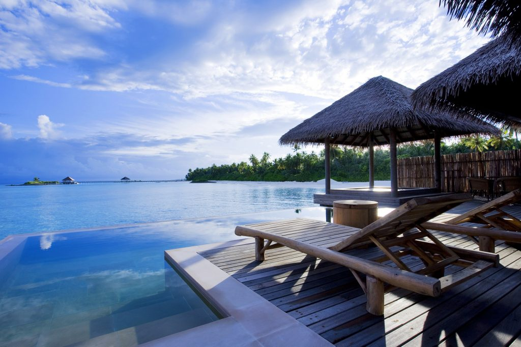 Where To Travel For The Best Active Couples Holidays | Surf & Yoga in the Maldives: COMO Maalifushi Surf Retreat